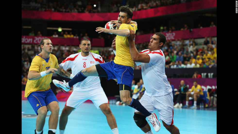 Sweden's Dalibor Doder jumps to shoot during a men's handball preliminary match between Sweden and Tunisia.