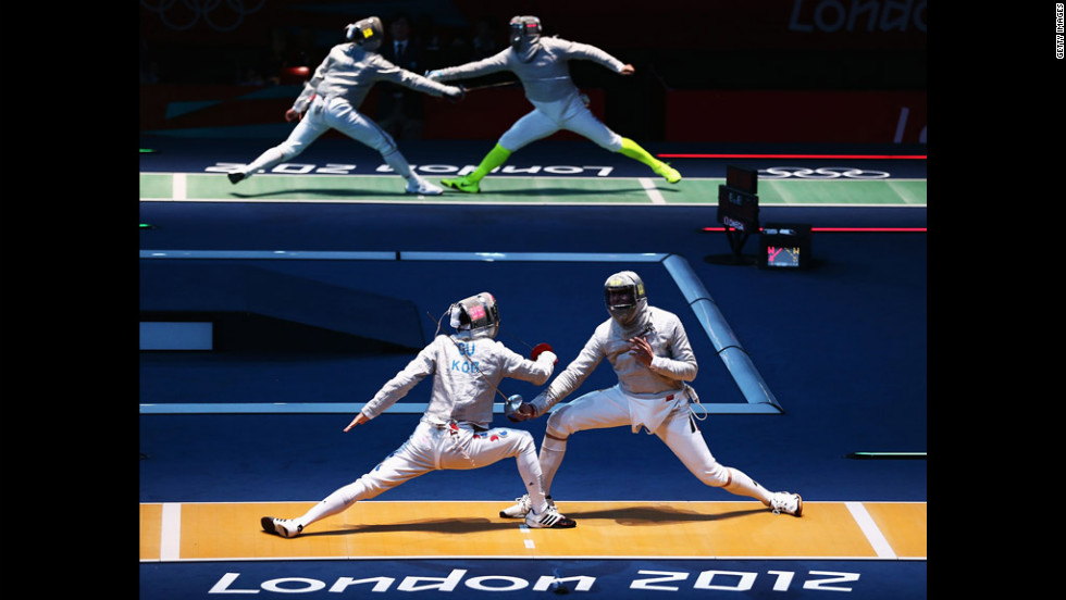 South Korea's Bongil Gu, left, and Max Hartung of Germany face off in the men's saber individual fencing round.