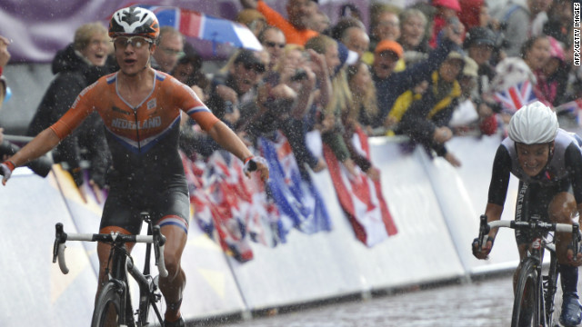 Marianne Vos crosses the line ahead of Lizzie Armitstead to win gold in the women's road race.