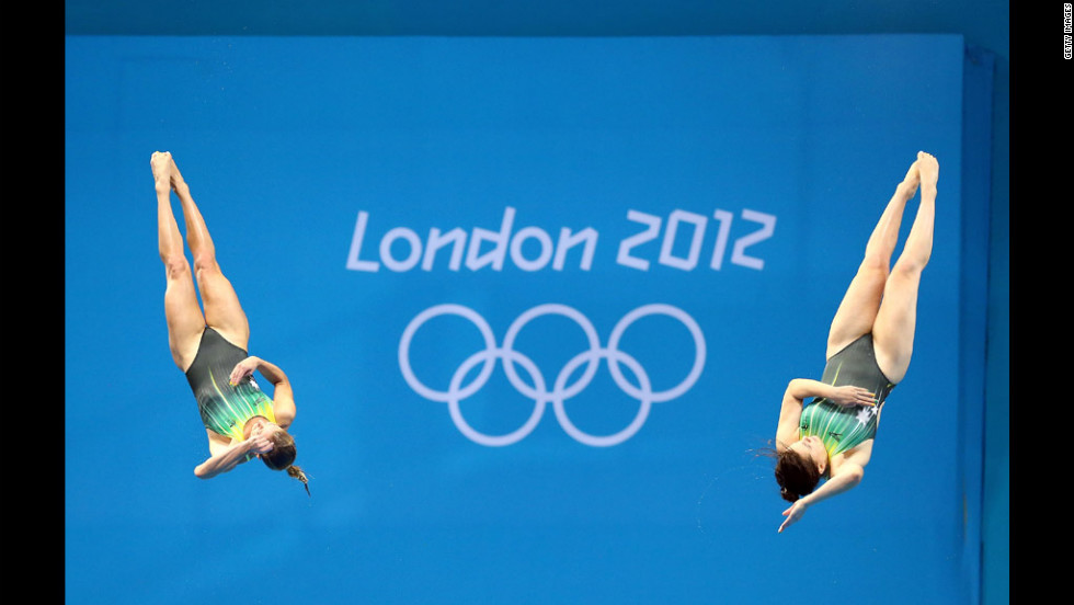 Sharleen Stratton and Anabelle Smith of Australia compete in the women's synchronized 3-meter springboard final at the Aquatics Centre.