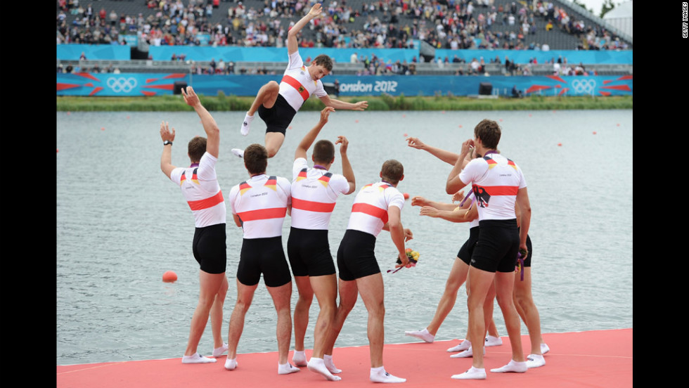Germany's rowing team throws their cox, Martin Sauer, into the water after winning gold in the men's eight final.