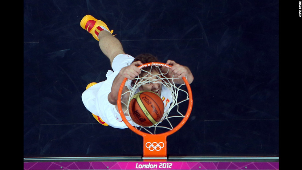 Spain's Pau Gasol dunks the ball against China at the Basketball Arena in London.