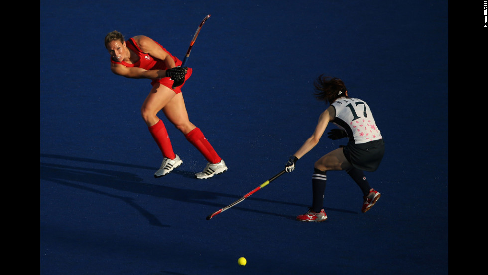 Crista Cullen of Great Britain competes against Masako Sato of Japan during a women's field hockey match.