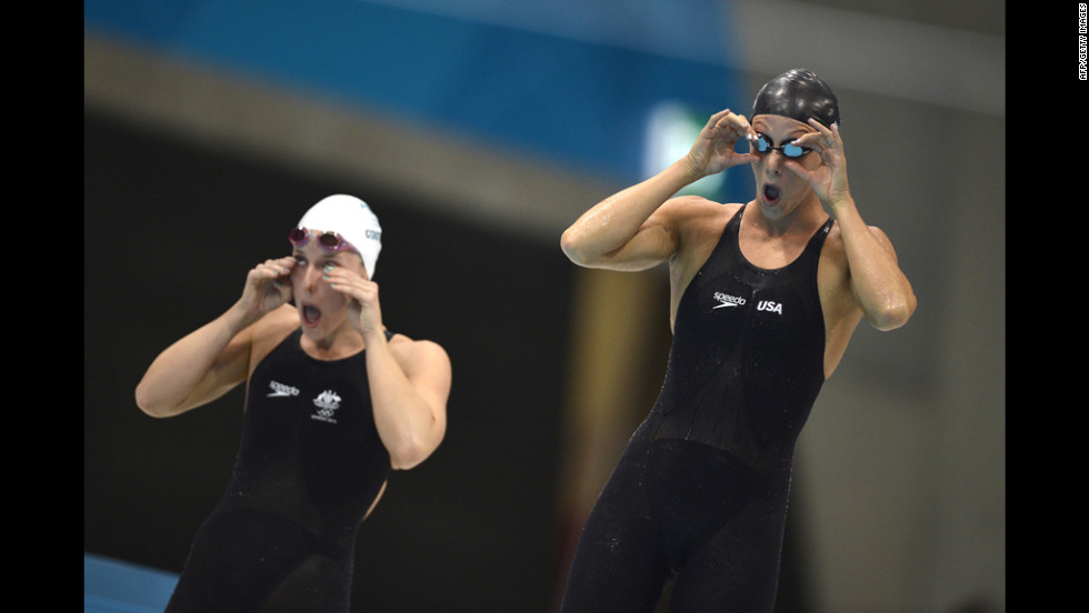 U.S. swimmer Dana Vollmer, right, prepares for the women's 100-meter butterfly final. Vollmer went on to win a gold medal and set a world record in the event, becoming the first woman to go under 56 seconds.