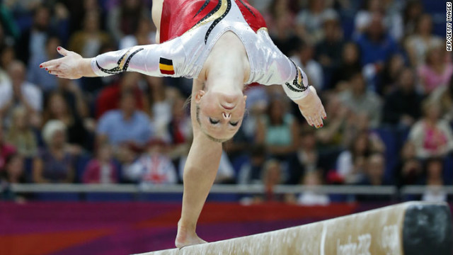 Belgian gymnast Gaelle Mys competes on the balance beam during the women's artistic gymnastics qualification event.