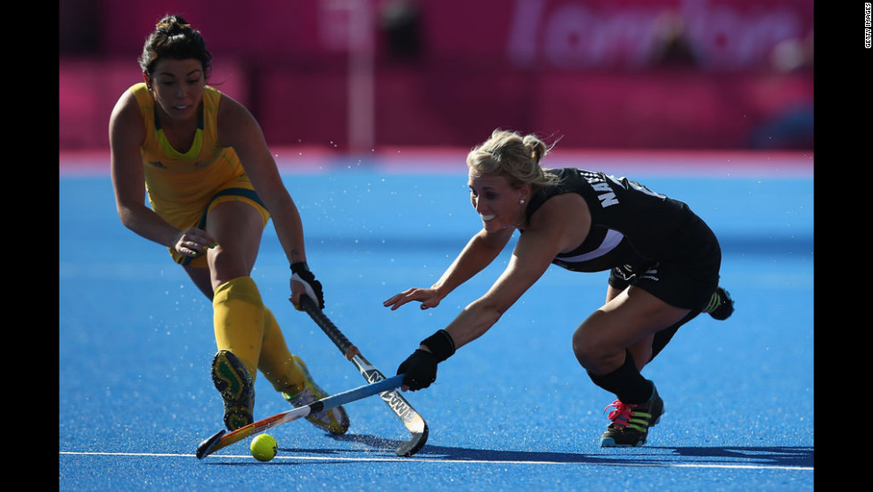 Australia's Jade Close, left, and New Zealand's Emily Naylor, right, compete in field hockey.