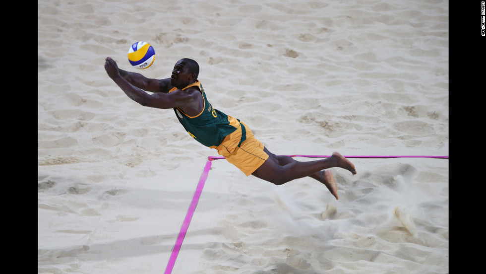 Freedom Chiya of South Africa dives for the ball against the United States during the men's beach volleyball preliminary round.