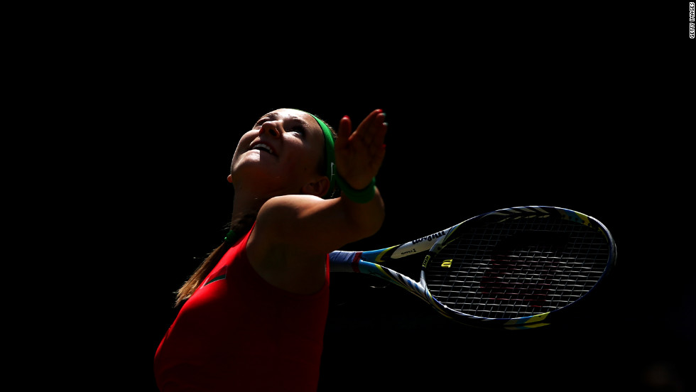 Victoria Azarenka of Belarus serves during the women's singles tennis match against Irina-Camelia Begu of Romania on Monday.