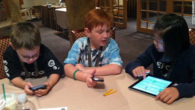 Kids learn how to search for vulnerabilities in mobile games at Def Con 20 in Las Vegas.