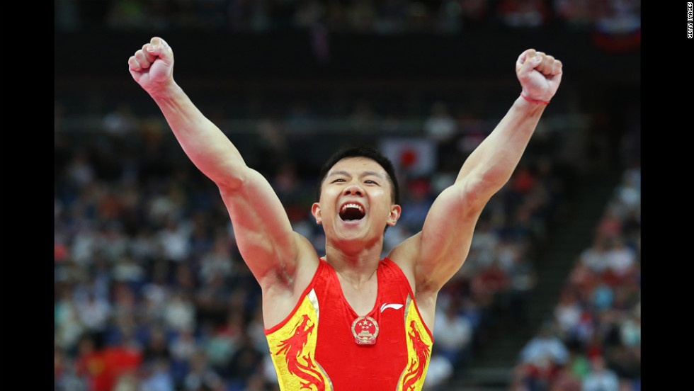 Yibing Chen of China reacts after completing the pommel horse in the artistic gymnastics men's team final.