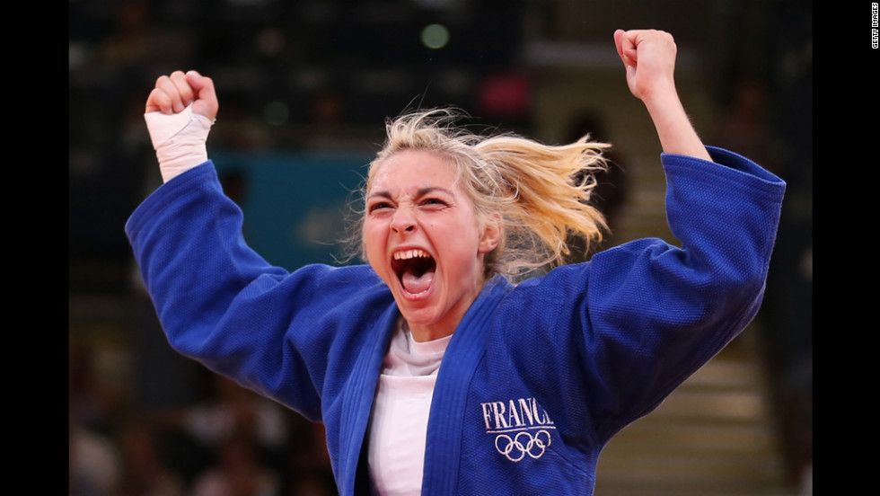 Automne Pavia of France celebrates her bronze medal B over Hedvig Karakas of Hungary during the women's judo on Monday.