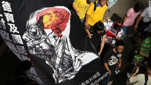 "Protester march against  implement national education in Hong Kong, claiming it amounts to Chinese patriotic ""brainwashing'."