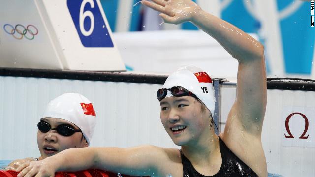 Swimmer Ye Shiwen, 16, raises her hand after winning the 400m race.