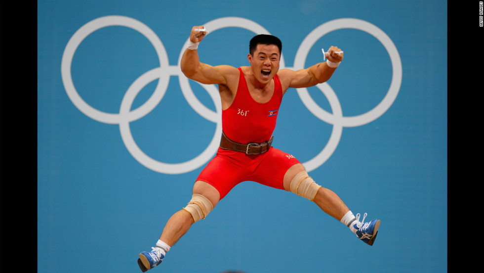 Un Guk Kim of North Korea celebrates his world record while competing in the men's 62-kilogram division weightlifting competition.