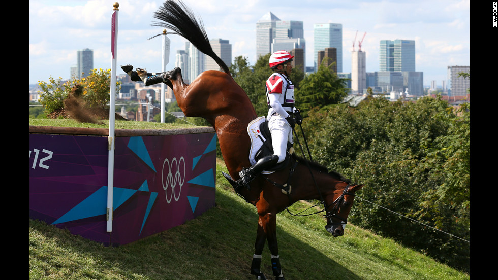 The cross country is particularly challenging. Here Atsushi Negishi of Japan riding Pretty Darling negotiates an obstacle.
