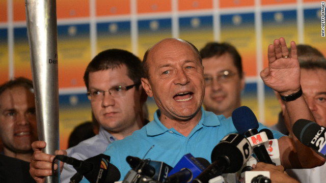 Romanian President Traian Basescu addresses reporters at his electoral campaign headquarters in Bucharest on July 29, 2012.