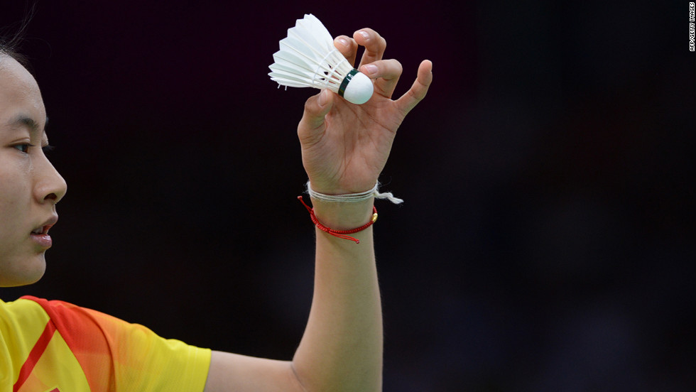 China's No. 1 seed Wang Yihan serves to Michele Li of Canada during the women's singles badminton match against Monday.