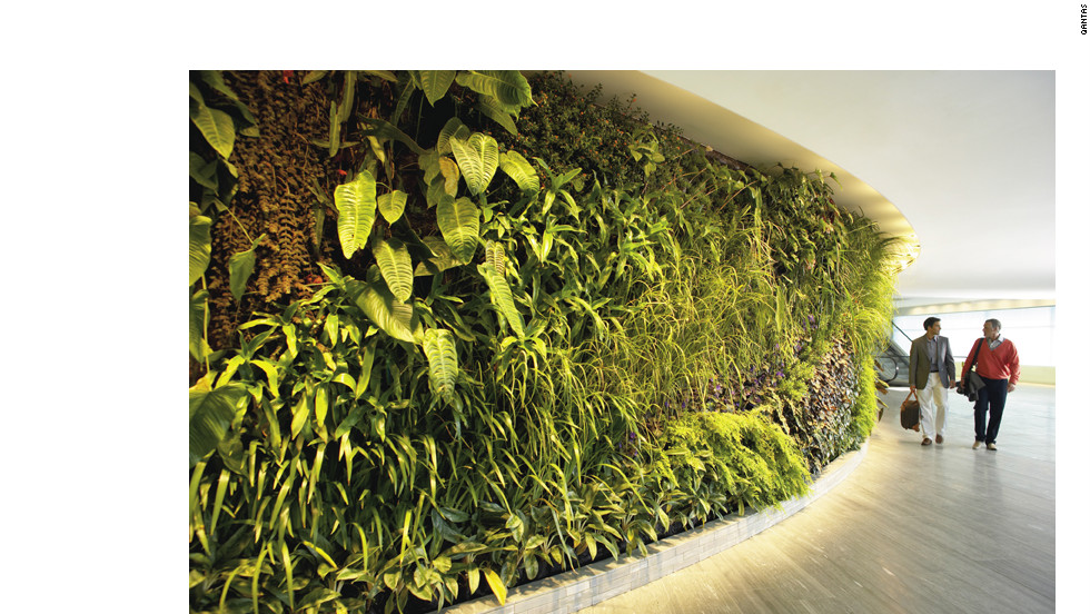 Qantas First Lounge at Sydney International Airport showcases a 98-foot, 8,400-plant vertical garden.