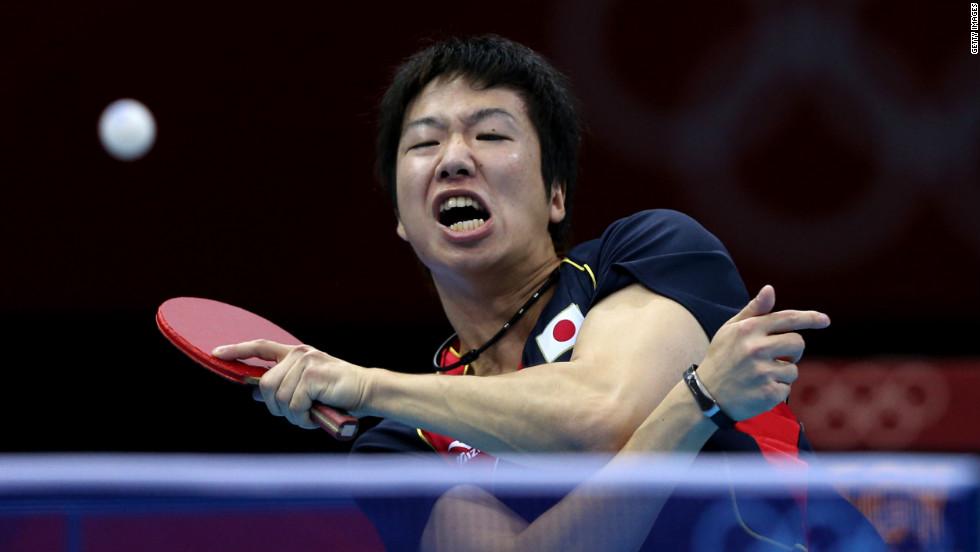 Jun Mizutani of Japan returns the ball during the men's singles table tennis third-round match against Elsayed Lashin of Egypt on Monday.