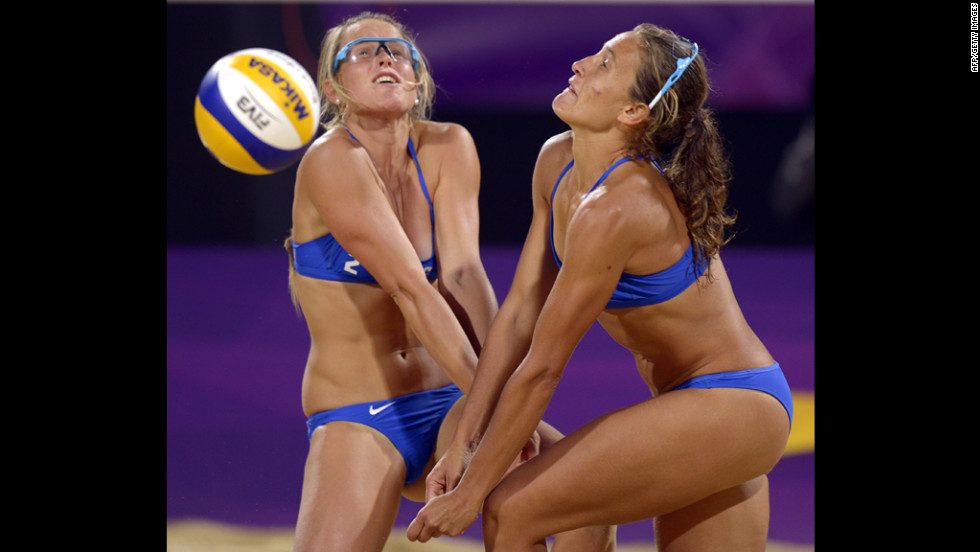 Argentina's Ana Gallay, right, and Maria Virginia Zonta go for the ball during the women's beach volleyball preliminary match against April Ross and Jennifer Kessy of the United States.