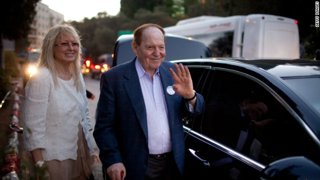 U.S.gaming tycoon Sheldon Adelson and his wife Miriam leave after U.S. Republican presidential candidate, former Massachusetts Gov. Mitt Romney delivered a speech outside the Old City on July 29, 2012 in Jerusalem.