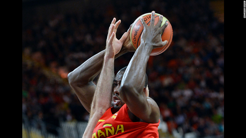 Spanish center Serge Ibaka fights for possession during a men's preliminary round basketball match against Australia on Tuesday.