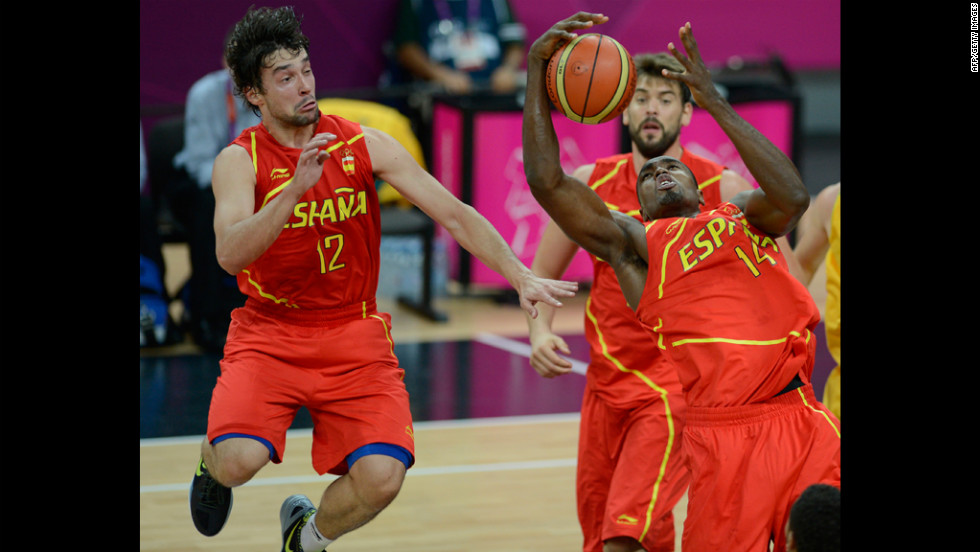Spanish center Serge Ibaka, right, makes a grab during Tuesday's game against Australia.