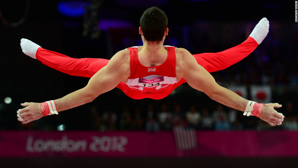 British gymnast Kristian Thomas competes at the horizontal bar during the men's team final of the artistic gymnastics event .