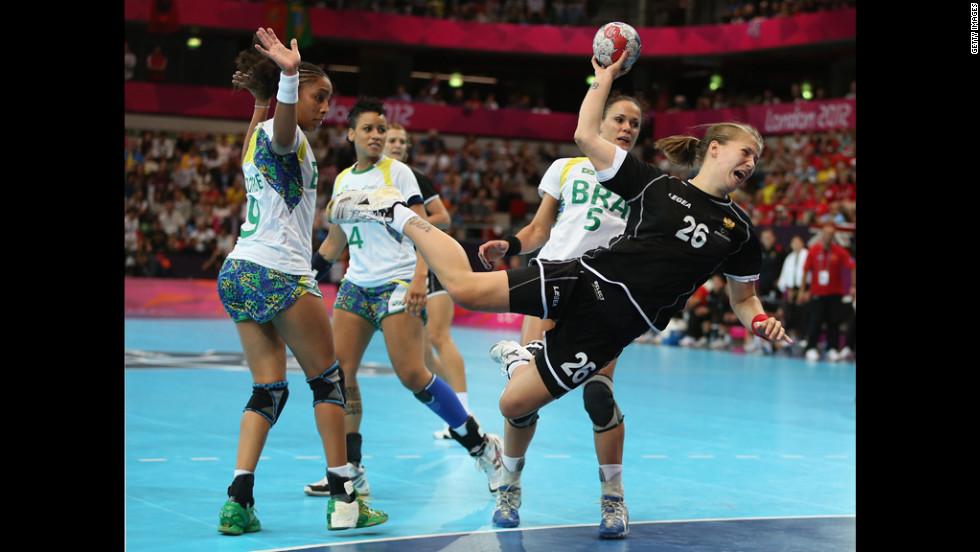 Suzana Lazovic of Montenegro shoots and scores during the women's handball preliminaries.