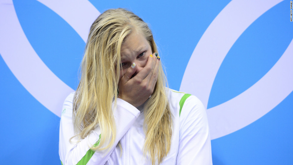 Lithuania's Ruta Meilutyte stands emotional on the podium to recieve the gold medal after winning the women's 100m breaststroke swimming event, beating fan favorites Rebecca Soni of the U.S. and Leisel Jones of Australia for the win.