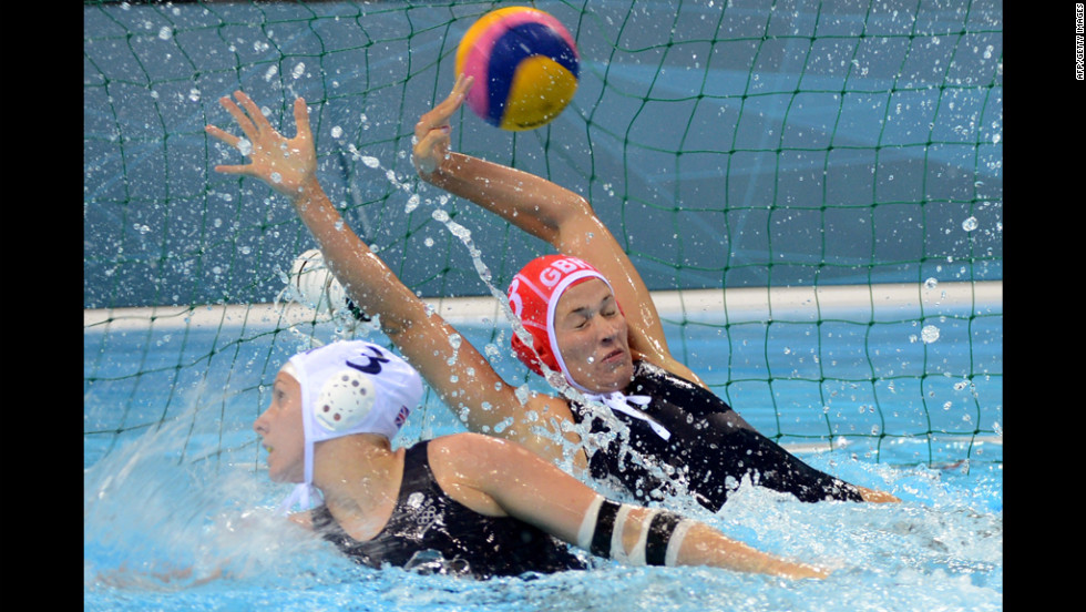 Britain's goalkeeper Rosie Morris, right, attempts to catch a ball hit by Russia during the water polo preliminary match.