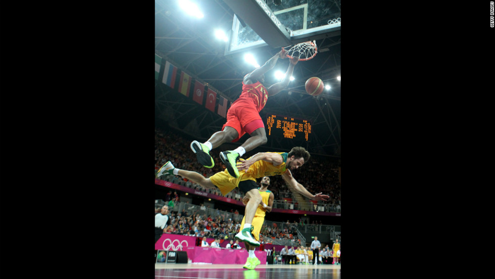 Serge Ibaka of Spain dunks over Matt Nielsen of Australia during a men's basketball preliminary round match Tuesday.