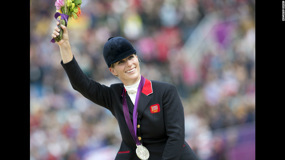 Britain's Zara Phillips waves to the crowd after the British equestrian team won the silver medal in eventing. As part of the British team, Phillips, Queen Elizabeth II's granddaughter, becomes the first member of Britain's royal family to take home an Olympic medal.