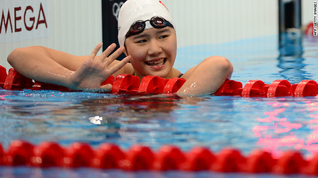 China's Ye Shiwen waves after the finish of the women's 200m individual medley semi-final swimming event at the London 2012 Olympic Games on July 30, 2012 in London. AFP PHOTO / MARTIN BUREAU (Photo credit should read MARTIN BUREAU/AFP/GettyImages)