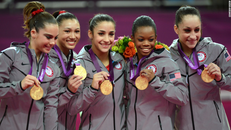 From left, gold medalist U.S. team McKayla Maroney, Kyla Ross, Alexandra Raisman, Gabrielle Douglas and Jordyn Wieber celebrate their gold medal in the women's gymnastics team final on Tuesday. They won the United States' seventh gold medal.