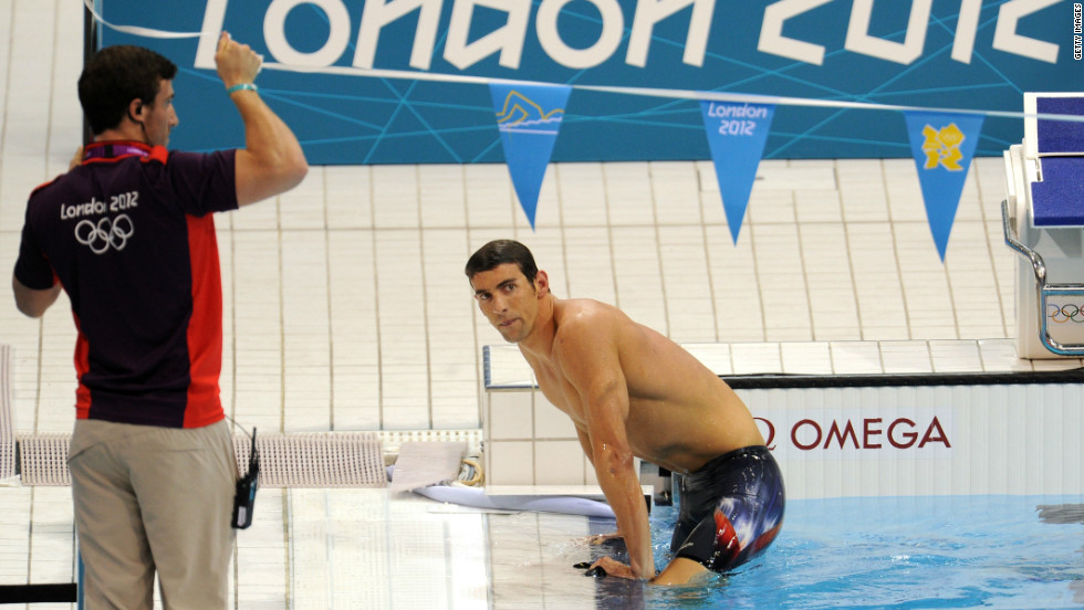 Phelps climbs out of the pool in London after a shock fourth-place finish in the 400-meter medley.