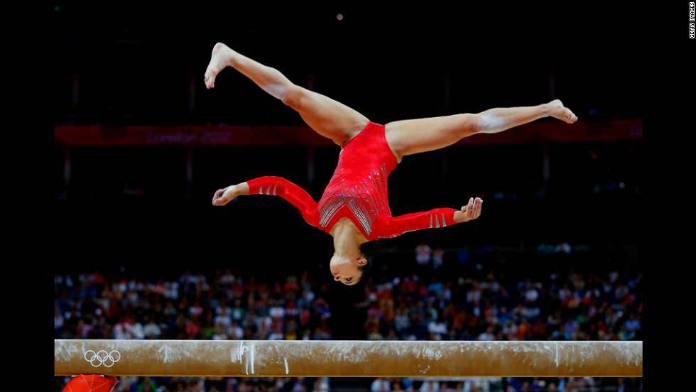 Alexandra Raisman of the United States competes on the balance beam in the  gymnastics women's team final.