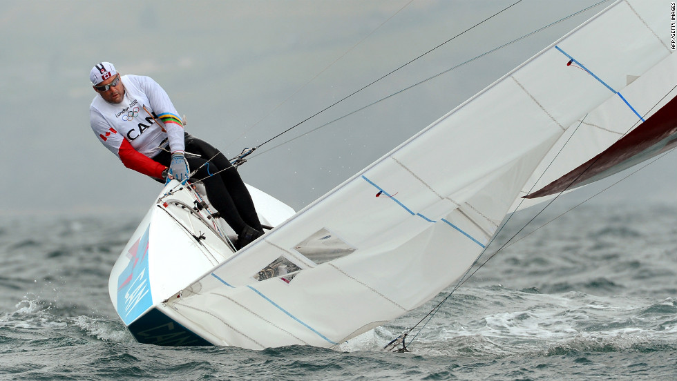 Canada's Tyler Bjorn (shown) and Richard Clarke struggle to keep their keelboat upright in the star sailing class in Weymouth, England.