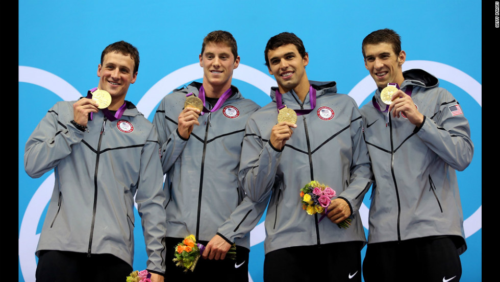From left, gold medallists Ryan Lochte, Conor Dwyer, Ricky Berens and Michael Phelps pose on the podium during the medal ceremony for the Men's 4x200-meter freestyle relay final on Tuesday.