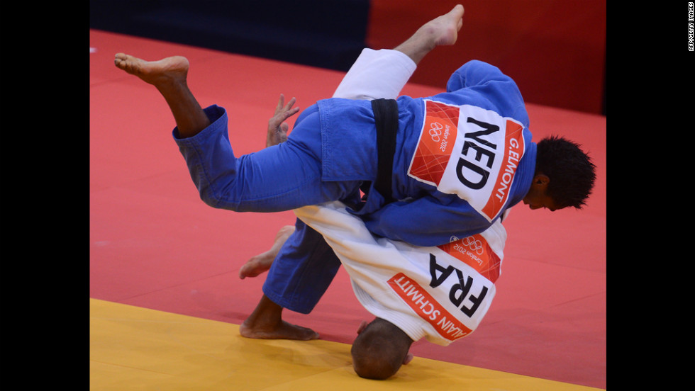 France's Alain Schmitt, in white, competes with the Netherlands' Guillaume Elmont during the men's under 81-kilogram judo contest match Tuesday.