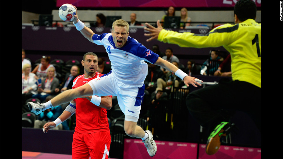 Iceland's Gudjon Valur Sigurdsson jumps to shoot during the men's preliminary handball match against Tunisia on Tuesday.