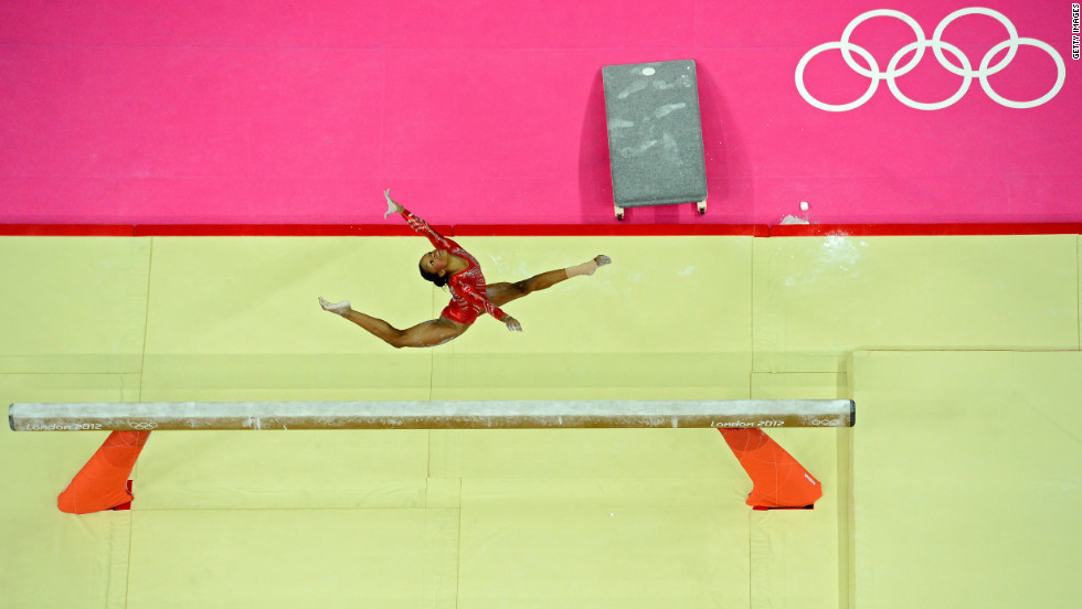 Gabrielle Douglas of the United States performs on the balance beam in the women's gymnastics team final.