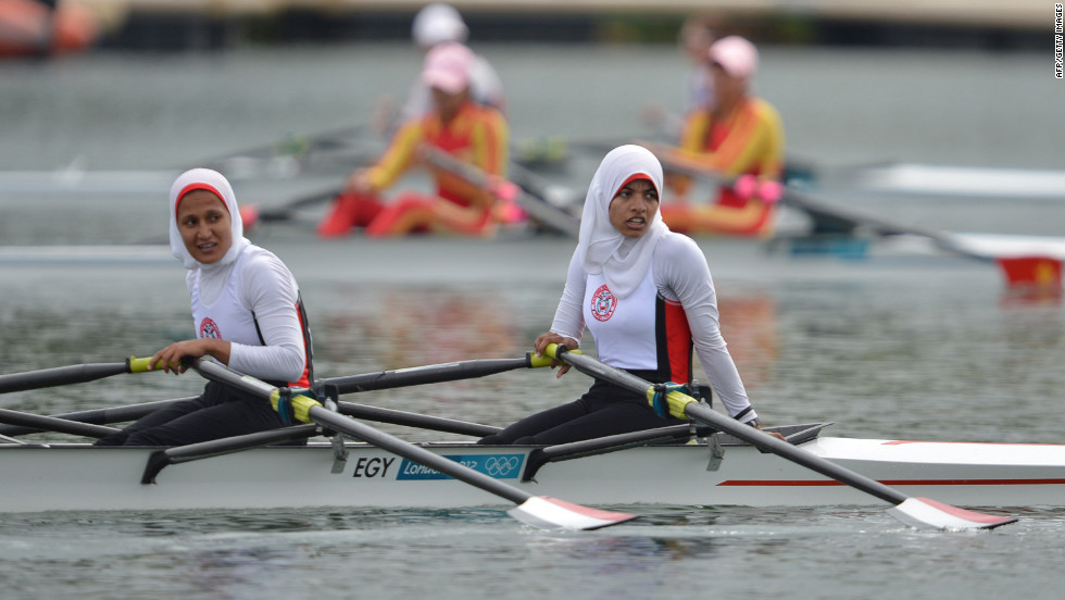 Egypt's Sara Mohamed Baraka, right, and Fatma Rashed rest after competing in the women's rowing lightweight double sculls repechages event Tuesday.