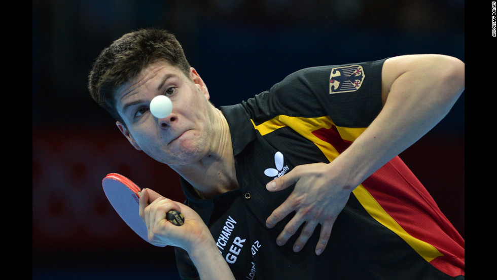 Germany's Dimitrij Ovtcharov eyes the ball before returning a shot to Denmark's Michael Maze in their table tennis men's singles match.