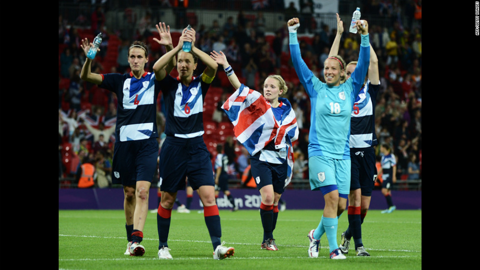 Britain's female football players celebrate their 1-0 win over Brazil.