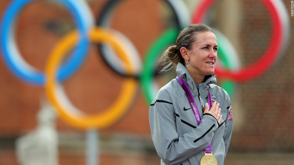 The 38-year-old mother of two, Kristin Armstrong of the United States, shows she can do it all as she celebrates during the medal ceremony after the women's individual time trial in London.