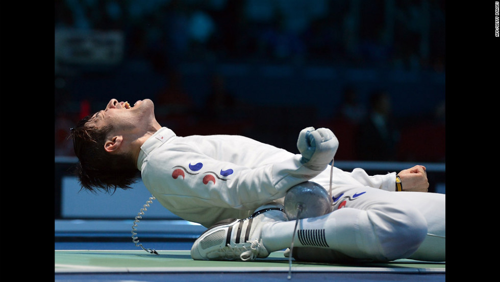 South Korea's Jung Jinsun celebrates his victory over Germany's Jorg Fiedler at the end of their men's epee fencing bout.