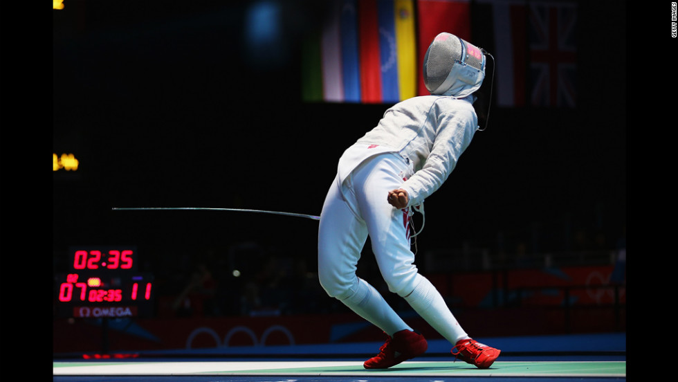 Amira Ben Chaabane of Tunisia celebrates a point against Xiaodong Chen of China in the women's saber individual round 32 match.