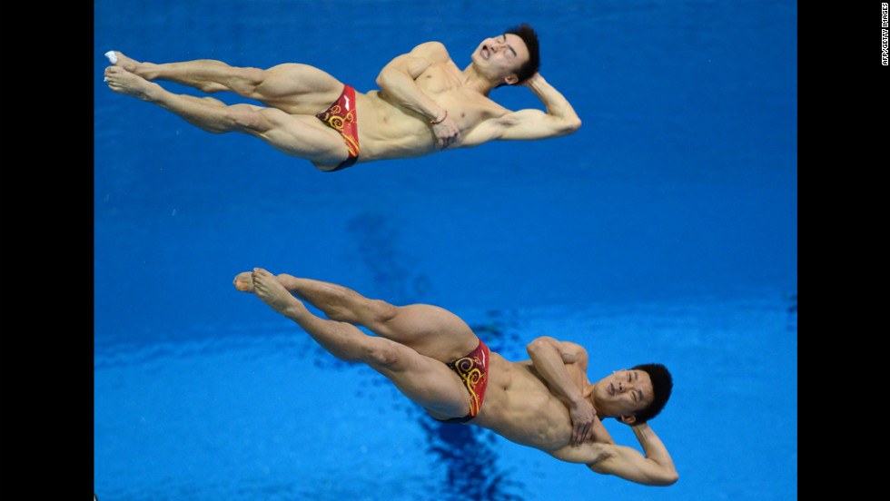 China's Qin Kai and Luo Yutong compete in the men's synchronized 3-meter springboard diving event.