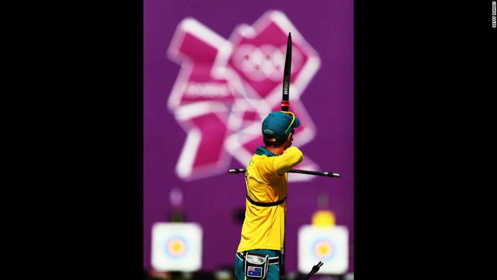 Taylor Worth of Australia competes in an elimination archery match against Brady Ellison of the United States.